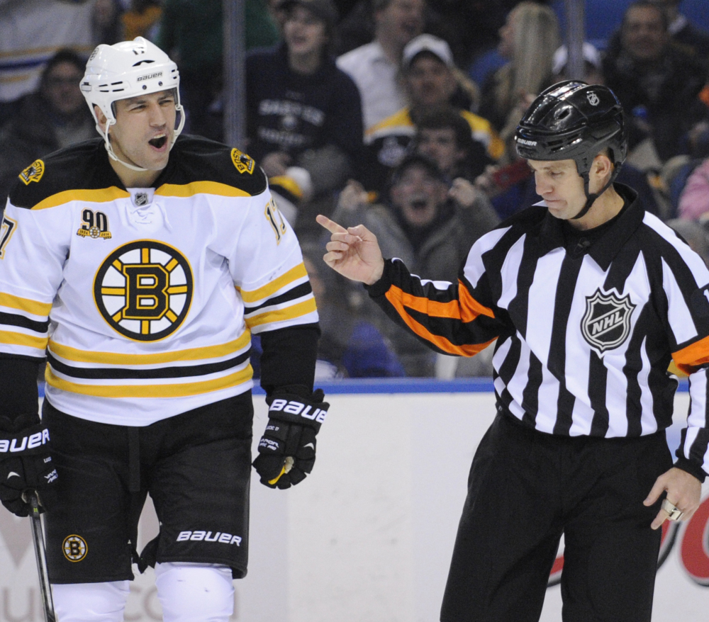 Milan Lucic of the Boston Bruins reacts to a boarding call by referee Brian Pochmara during the second period of a 5-4 overtime loss Wednesday at Buffalo.