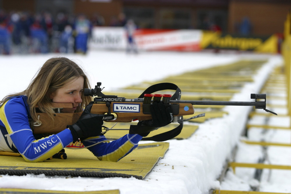 Wearing her Maine Winter Sports Center jersey, Meagan Toussaint of Madawaska takes aim in a biathlon competition. A Presque Isle native has given the center $100,000 and an additional matching grant of $400,000.