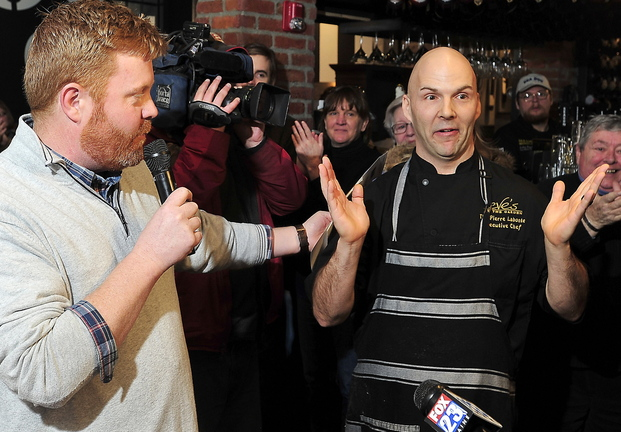 Event organizer Jim Britt, left, announces the winner of Friday's breakfast cook-off: chef Tim Labonte from Eve's at the Garden, Portland Harbor Hotel, who won in his first year of competing.
