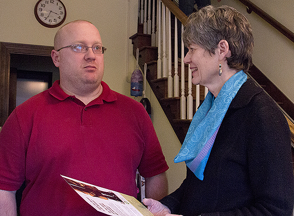 Susan Gold, a VISTA volunteer working with the Southern Maine Agency on Aging describes the Veterans Helping Veterans program to combat veteran Chris Kotch in Portland. The program aims to match volunteer veterans with vets who are older or disabled.