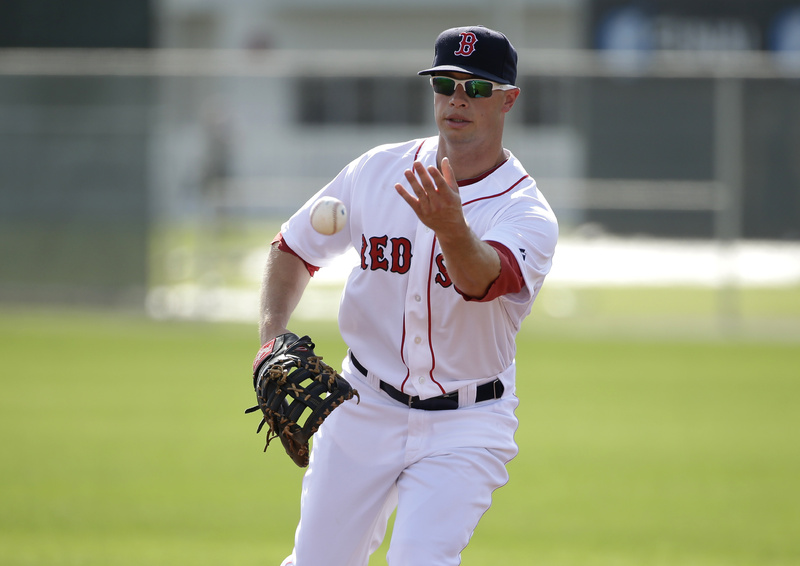 Boston Red Sox right fielder Daniel Nava works out on the field during spring training baseball practice Sunday in Fort Myers, Fla.