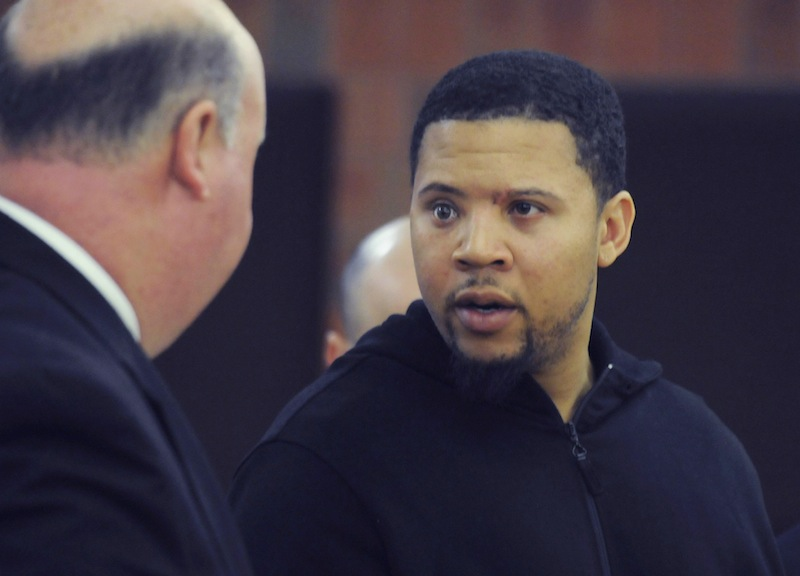 In this Friday, Oct. 4, 2013 file photo, Alexander Bradley, right, talks with his attorney Robert Pickering, left, during a court appearance at Hartford Superior Court on in Hartford, Conn. Bradley, who alleges he was shot by former New England Patriots tight end Aaron Hernandez, has been shot again in Connecticut. Hartford police Lt. Brian Foley says Bradley was shot several times in the leg Sunday night, Feb. 2, 2014, at the Vevo Lounge Bar & Grill, and was taken to a hospital. His condition hasn't been released.