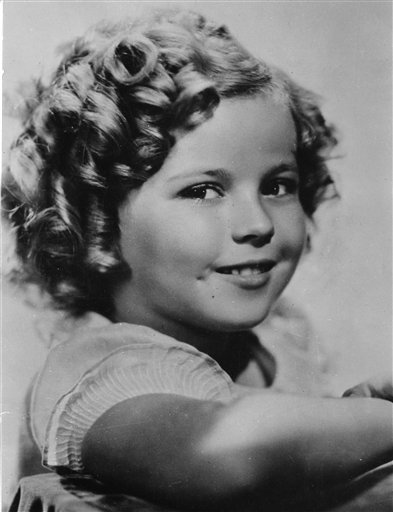 Shirley Temple was 8 years old in this 1936 photo. Publicist Cheryl Kagan says Temple, known in private life as Shirley Temple Black, died at age 85 surrounded by family at her home near San Francisco.