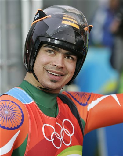 FILE - In this Feb. 12, 2006 file photo, India's Shiva Keshavan acknowledges the crowd after finishing his third run of the Men's Singles Luge at the Turin 2006 Winter Olympic Games in Cesana Pariol, Italy. Keshavan, India's top competitor at the upcoming 2014 Winter Olympics in Sochi says not being able to compete under the national flag because of a political dispute will not harm his performance. (AP Photo/David J. Phillip, File)