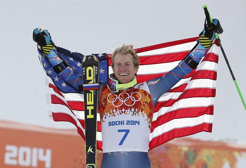 Men's giant slalom gold medalist Ted Ligety of the United States poses for photographers on the podium at the Sochi 2014 Winter Olympics, Wednesday, Feb. 19, 2014, in Krasnaya Polyana, Russia. (AP Photo/Christophe Ena) 2014 Sochi Olympic Games;Winter Olympic games;Olympic games;Spor