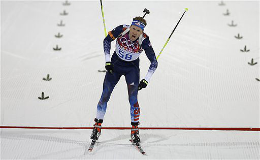 Lowell Bailey of Lake Placid, N.Y., crosses the finish line of the men's biathlon 20k individual race at the 2014 Winter Olympics on Feb. 13. He finished eighth, the best finish ever by an American.