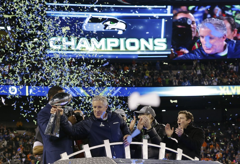 Seattle Seahawks head coach Pete Carroll holds the Vince Lombardi Trophy as he celebrates after the NFL Super Bowl XLVIII football game against the Denver Broncos Sunday, Feb. 2, 2014, in East Rutherford, N.J. The Seahawks won 43-8.