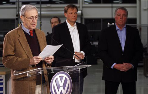 Retired circuit judge Sam Payne, left, announces that Volkswagen employees voted to deny representation by the United Auto Workers union. Behind him are Frank Fischer, chairman and CEO of the Volkswagen Group of America, center, and Gary Casteel, UAW Region 8 director. United Auto Workers