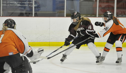 Charlotte Smith of Gorham/Bonny Eagle, center, looks to shoot during Tuesday's game against Biddeford. Biddeford won 1-0 in overtime.