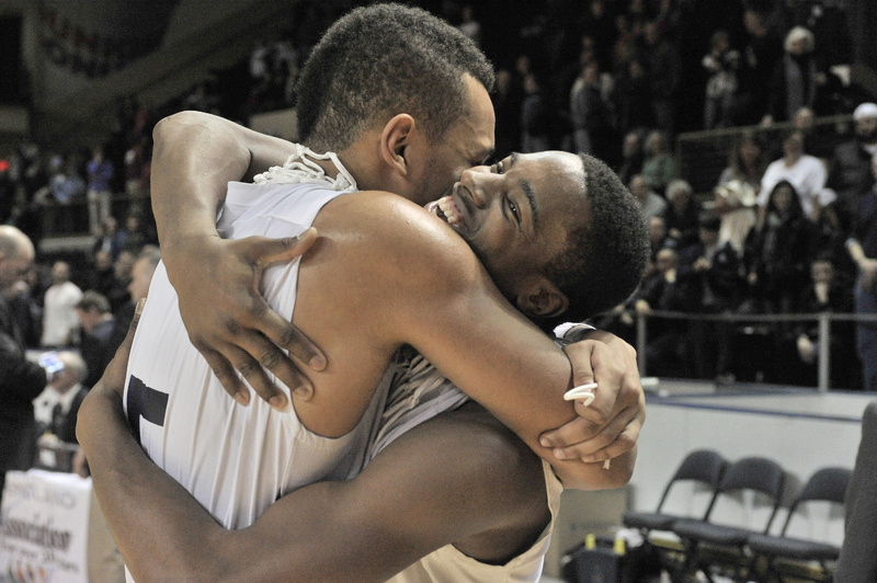 Portland's Matt Talbot, left, and Jayvon Pitts-Young, share a hug after winning the boys' state Class A basketball championship on Saturday. game.