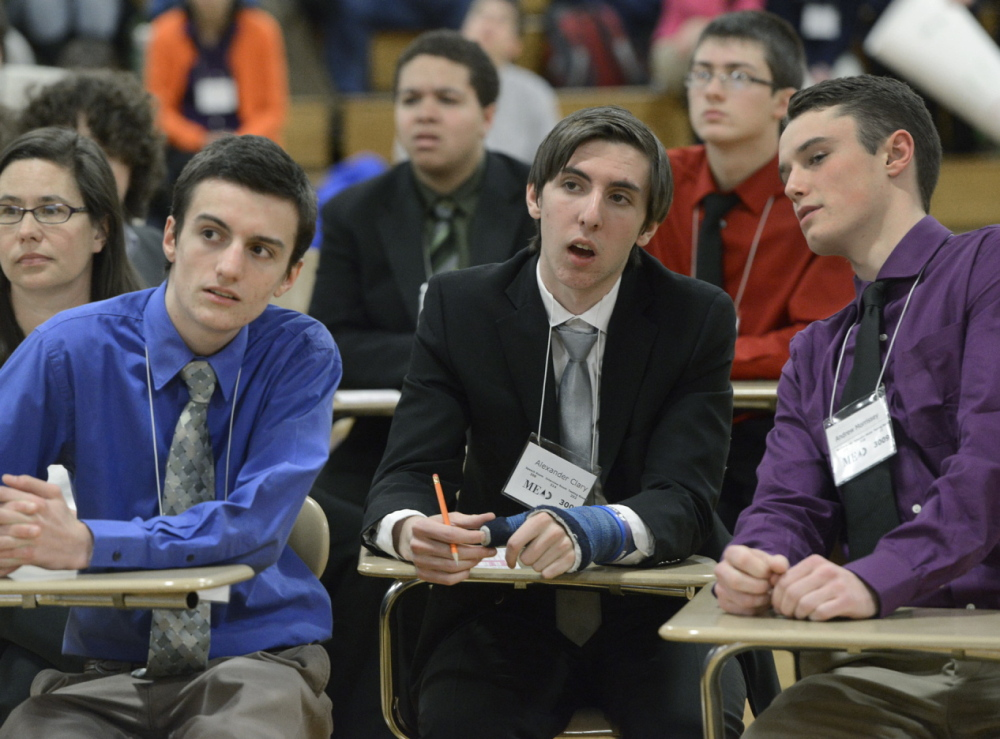 Scarborough's Mason Roach, Alexander Clary and Andrew Morrissey consider an answer during the Maine Academic Decathlon at Deering High School on Saturday.