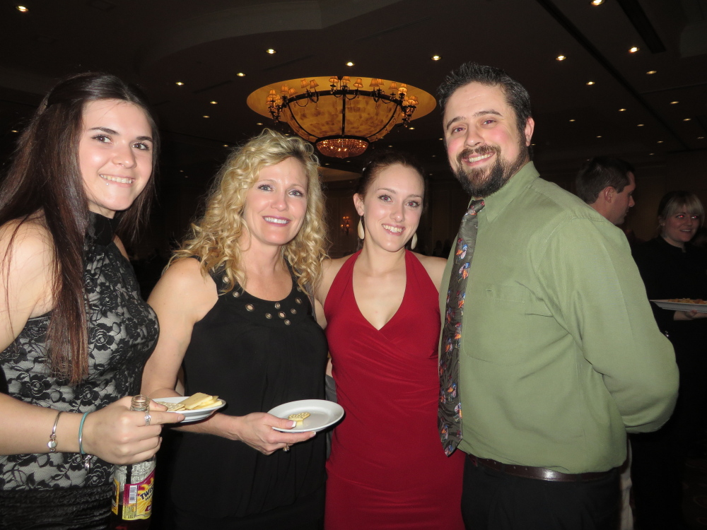 Makyla Hamlin, office manager at TLC Realty in Windham, Tammy Caron, owner of TLC Realty, and Andrea and Benjamin O'Brion of Prospect Mortgage in South Portland.