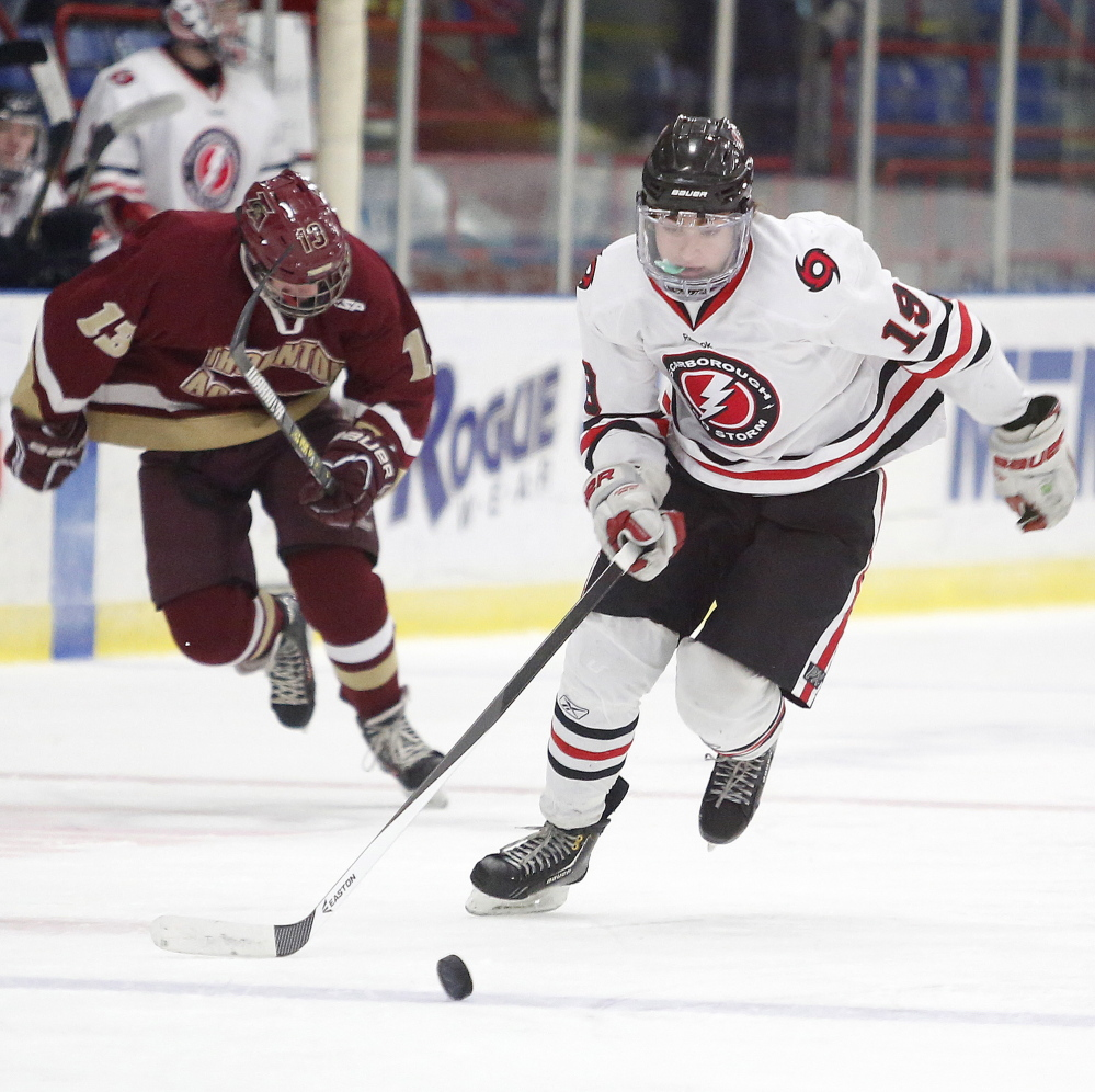 Matt Henderson of Scarborough breaks away from Thornton Academy's Walsh Troiani-Gagner on his way to a short-handed goal Saturday during a Westerrn Class A boys' hockey semifinal at the Colisee in Lewiston. Scarborough won, 7-1.