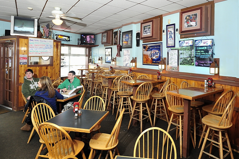 Barbara Bushey enjoys lunch with sons Billy, left, and Zach at Samuel's Bar & Grill at Morrill's Corner in Portland.