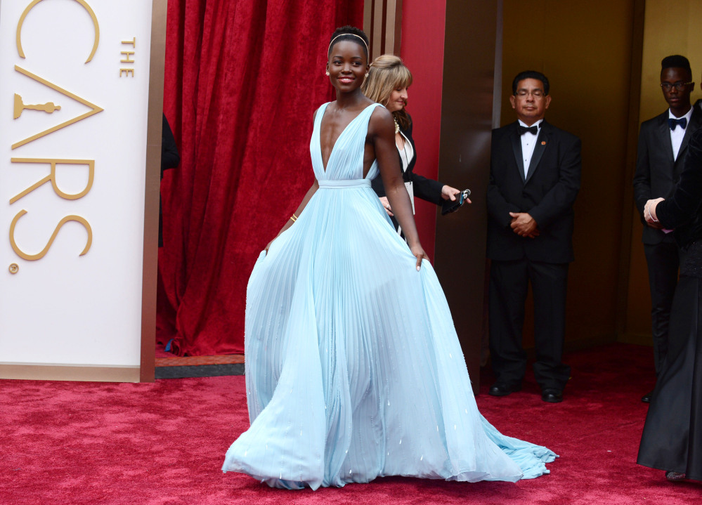 Lupita Nyong'o arrives at the Oscars on Sunday at the Dolby Theatre in Los Angeles.