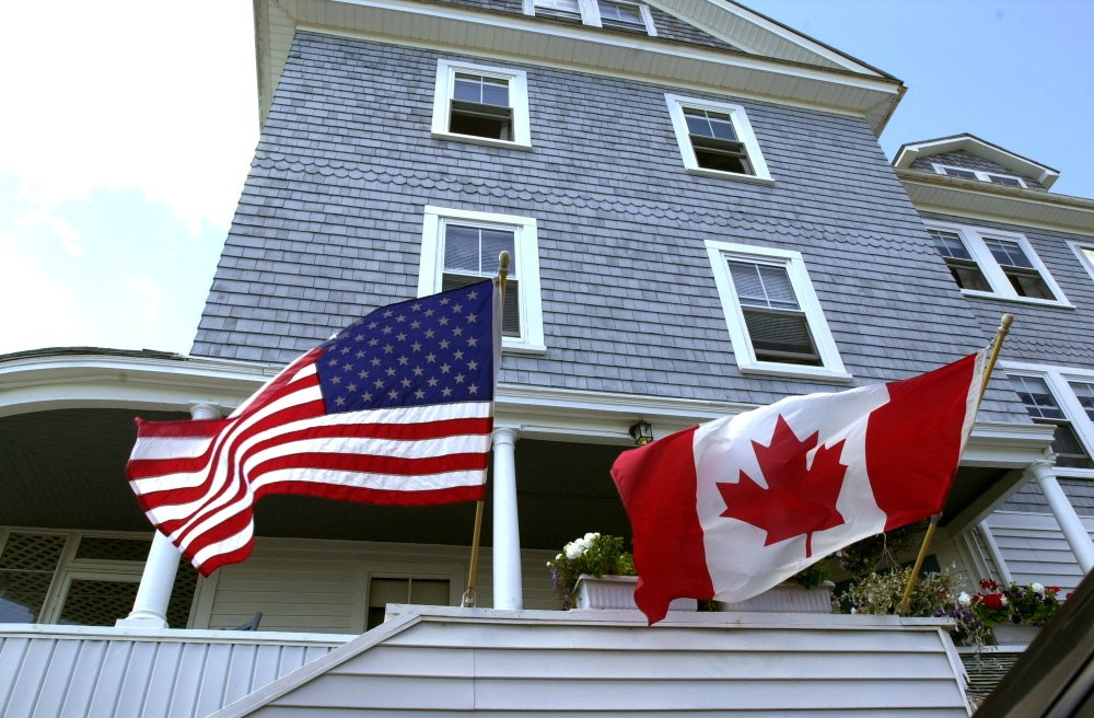 Many businesses in Ocean Park in Old Orchard Beach cater to Canadian tourists. An example is these flags flying at the Webfoot Inn.