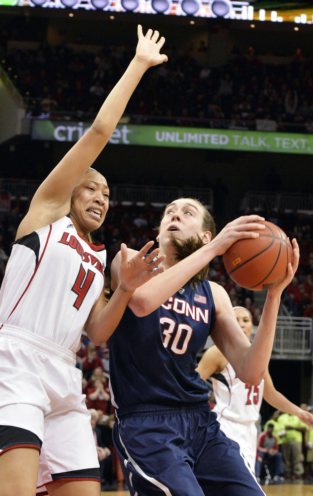 Connecticut's Breanna Stewart, right, looks to score against Louisville's Antonita Slaughter during the Huskies' 68-48 win Monday at Louisville, Ky.
