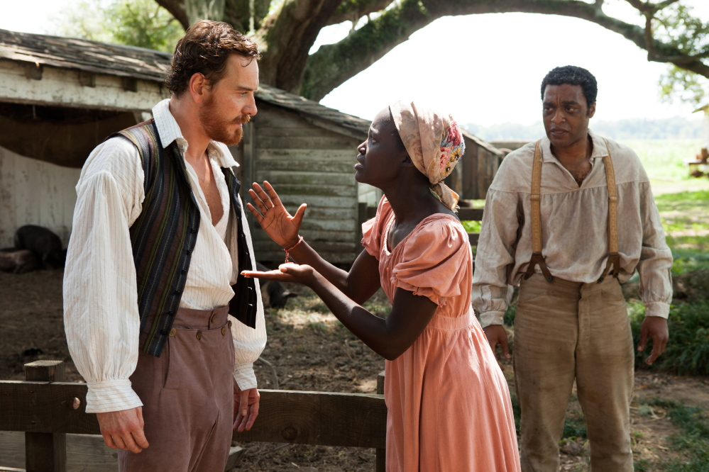 """Michael Fassbender, Lupita Nyong'o and Chiwetel Ejiofor, right, in """"12 Years a Slave."""""""