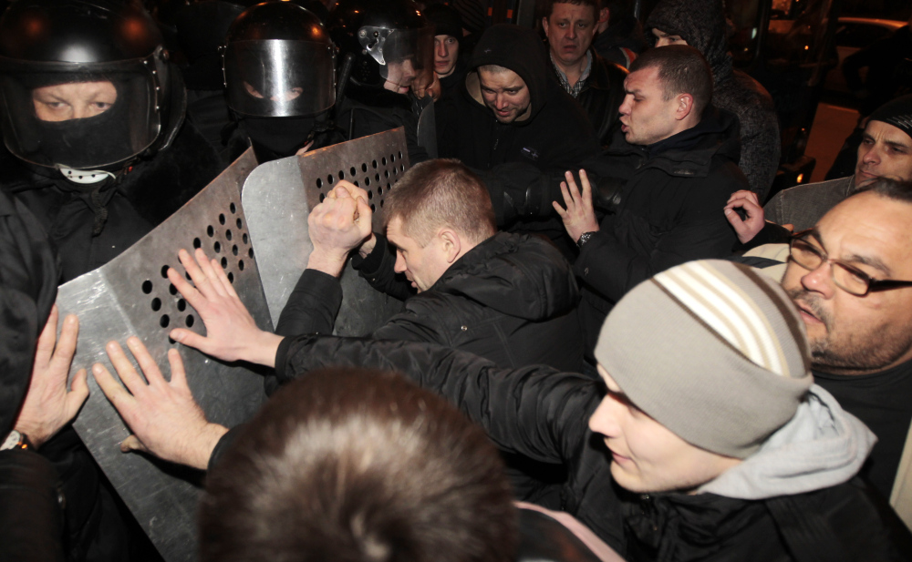 Ukrainian riot police officers block pro-Russian supporters of activist Pavel Gubarev during a rally in Donetsk, Ukraine, on Thursday.