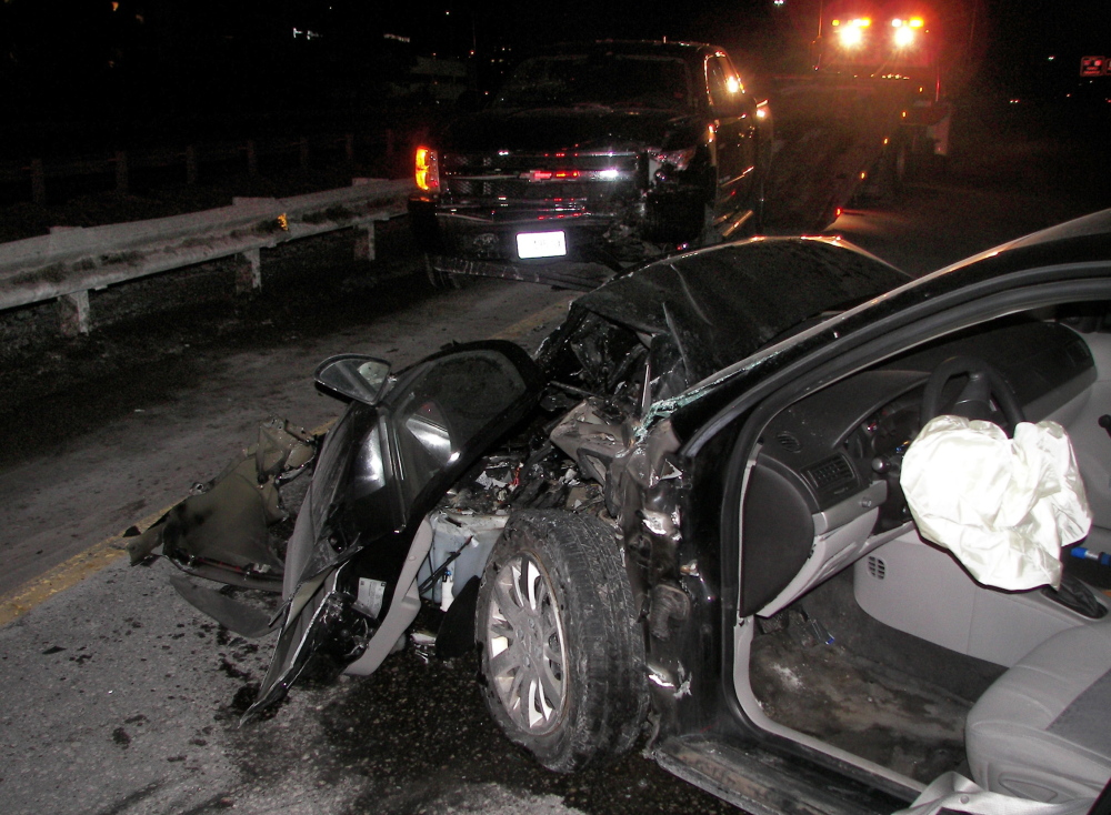 This photo provided by police shows the damage done to a Chevrolet Cobalt after a collision on I-295 Wednesday night with an alleged wrong-way driver. The Cobalt's driver, Amy Turner, was in fair condition at Maine Medical Center Friday.