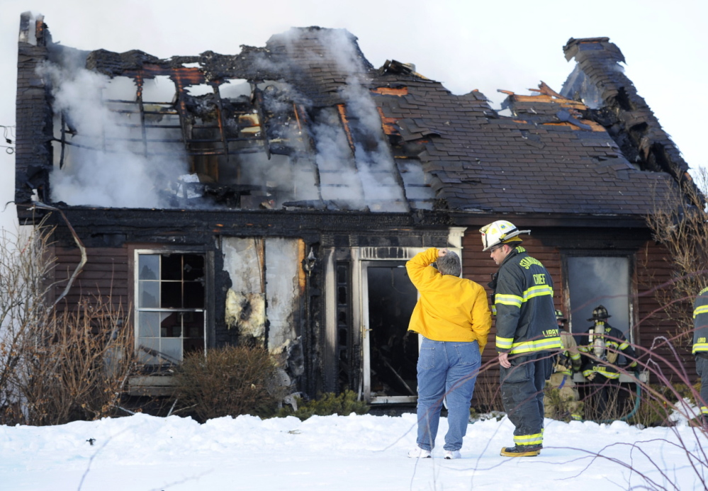A cigarette tossed outside near the front door of this home in Standish touched off a fire that destroyed the house Friday. Fire Chief Brent Libby, seen talking with homeowner Denise Dyer, said the fire at 1055 Chadbourne Road – Route 35 – was reported by a passerby shortly after 3 p.m. When firefighters arrived, the fire had spread through the house and out the roof, Libby said. No one was injured in the blaze.