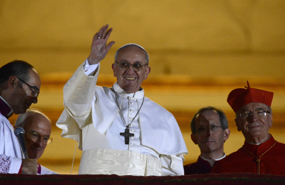 Pope Francis appears on the balcony of St. Peter's Basilica after his election at the Vatican on March 13, 2013.