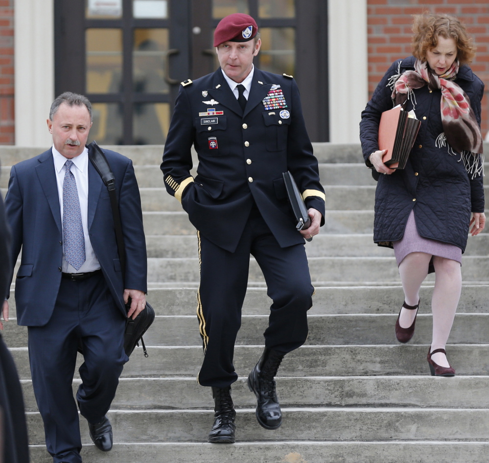 Army Brig. Gen. Jeffrey Sinclair leaves the courthouse with attorneys Richard Scheff, left, and Ellen Brotman at Fort Bragg in Fayetteville, N.C., on Tuesday.