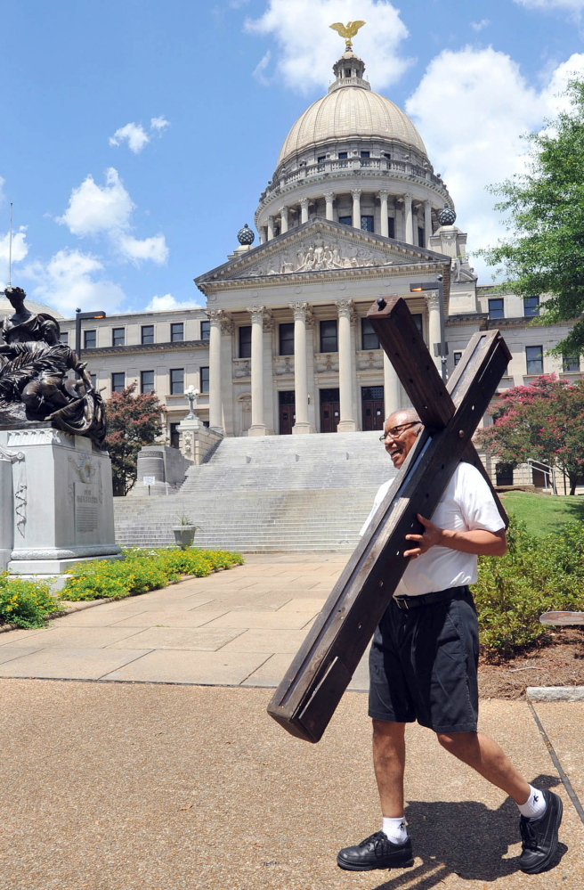 """A man heads for a religious gathering outside Mississippi's Capitol in 2013. A """"religious-freedom"""" bill widely seen as a door to discrimination of gays is being debated in the state."""
