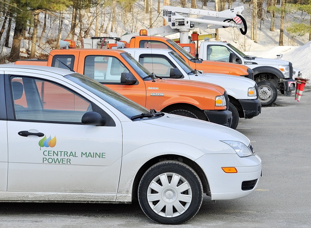 A proposed bill would require Central Maine Power to register its vehicles, like these at its Augusta service building, in the towns where they are kept, instead of in Augusta. That would cost Augusta hundreds of thousands of dollars, according to city officials.