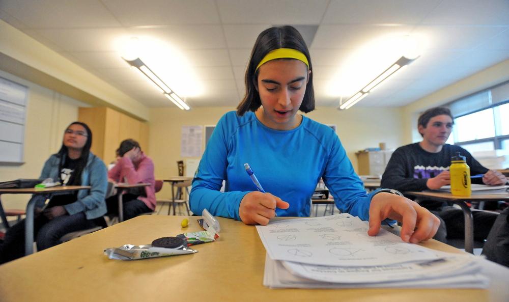 Ursula Hebert-Johnson, 17, a senior at Waterville Senior High School, works on a math equation Wednesday during math team practice.