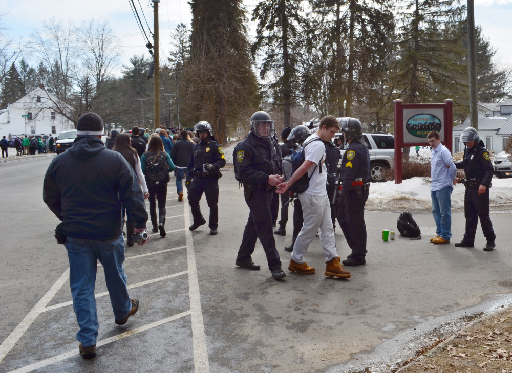 "Police detain revelers in the pre-St. Patrick's Day ""Blarney Blowout"" near the University of Massachusetts in Amherst, Mass., on Saturday. Police said 73 people were arrested."