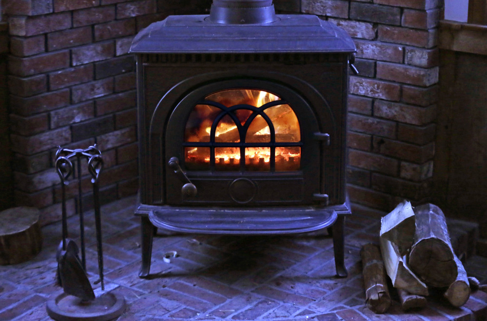 A wood stove heats a home in Freeport. Maine officials worry that an EPA proposal will prove too costly.