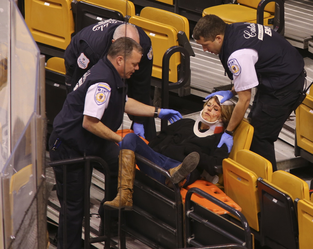 Emergency workers attend to Scarborough's Sabina Grasso after she was injured by a metal pole at TD Garden.