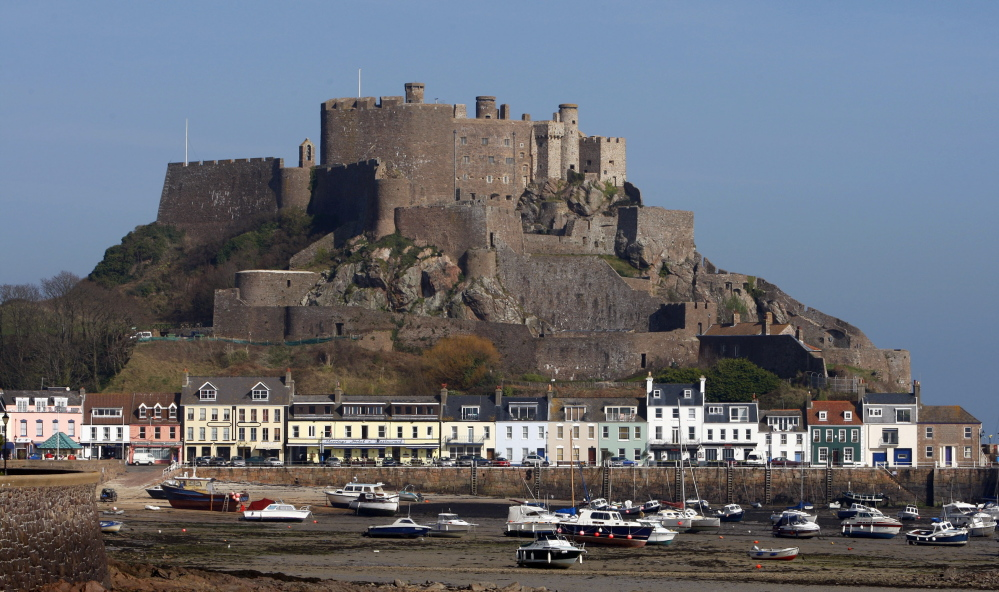Mont Orgueil Castle rises on Jersey, one of the British Channel Islands, which is an offshore tax haven.