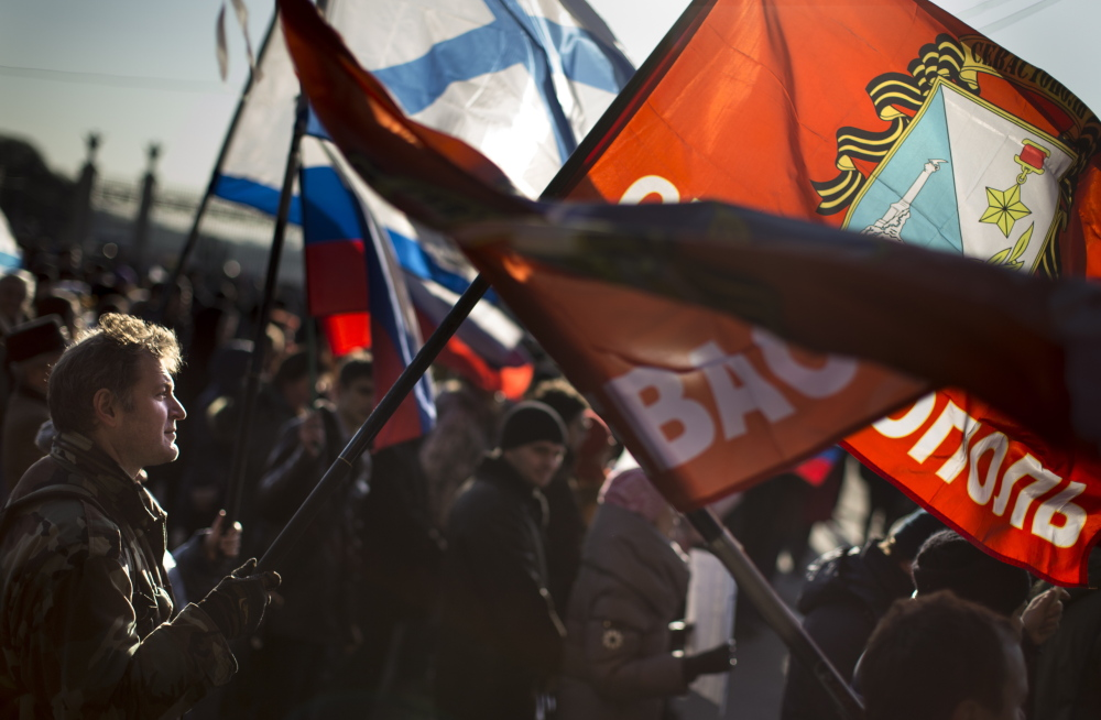 A demonstrator waves a flag during a March 1 rally in support of provinces in eastern and southern Ukraine, where many oppose the new Ukrainian leadership in Kiev.