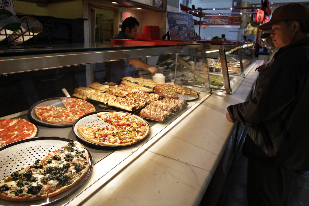 A customer looks at pizzas at a Sbarro restaurant in San Jose, Calif. The pizza and pasta chain says it is filing for bankruptcy reorganization protection after an effort to revitalize the chain's image with new recipes and ovens apparently didn't work.