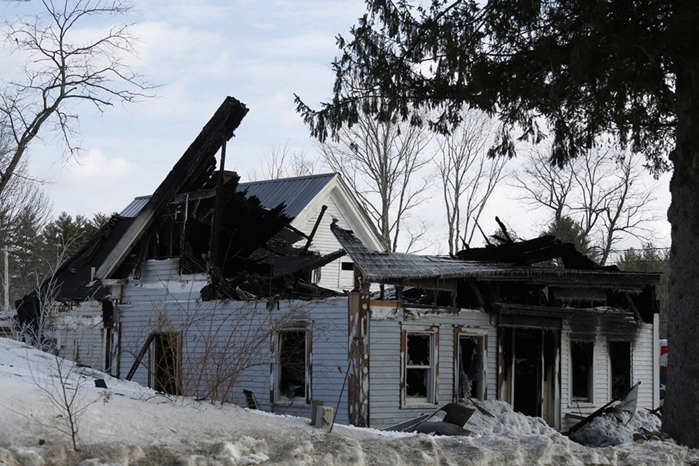 A woman who lived in this house in Limington was killed in an early-morning fire Monday.