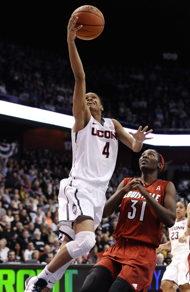 Connecticut's Moriah Jefferson goes up for a basket as Louisville's Asia Taylor trails the play during UConn's 72-52 conference title win Monday at Uncasville, Conn.