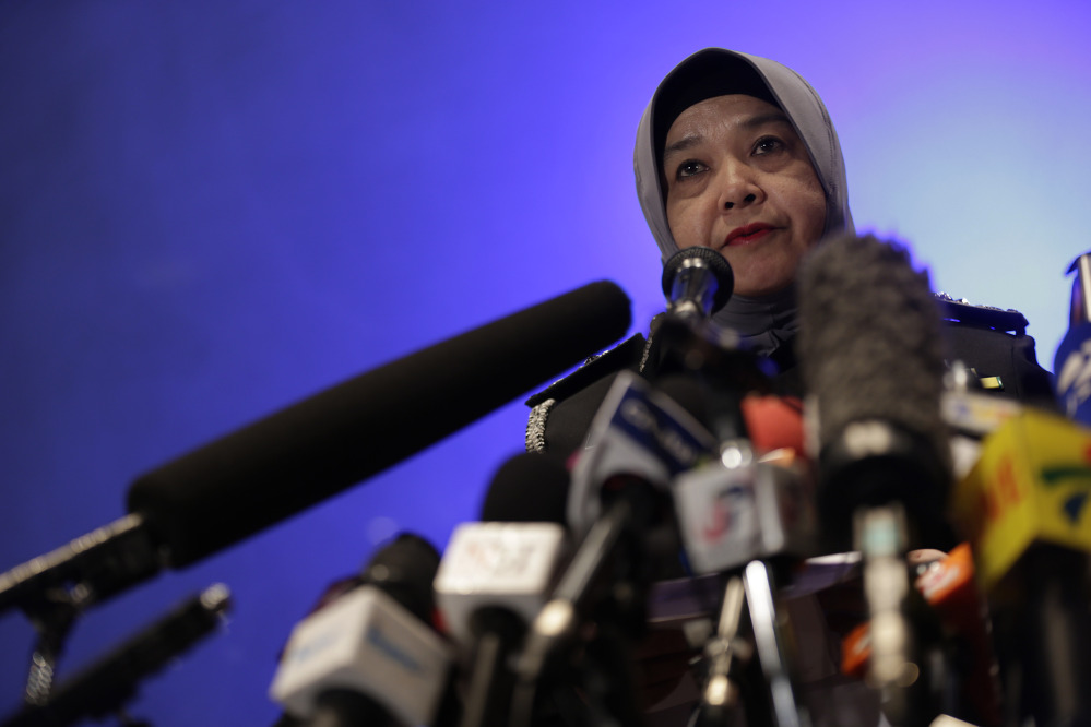 Malaysia's Director General of immigration, Aloyah Mamat, briefs the media about the entry and exit details of the two men onboard Malaysia Airlines jet MH370, who entered and left Malaysia with stolen passports.