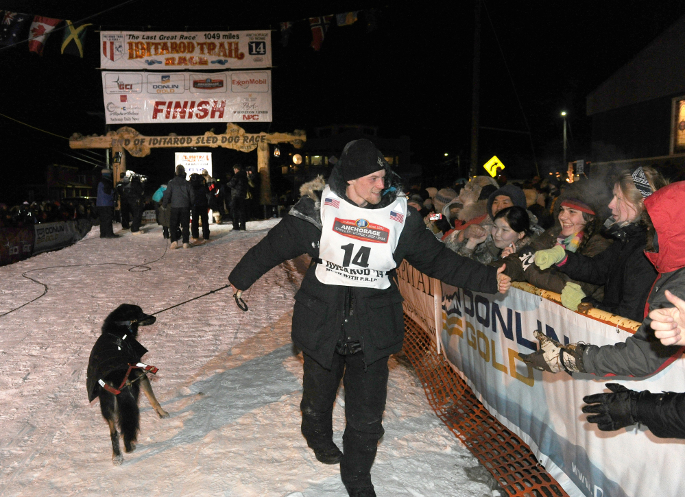 Dallas Seavey greets fans after winning the 2014 Iditarod Trail Sled Dog Race in Nome, Alaska, Tuesday, March 11, 2014.
