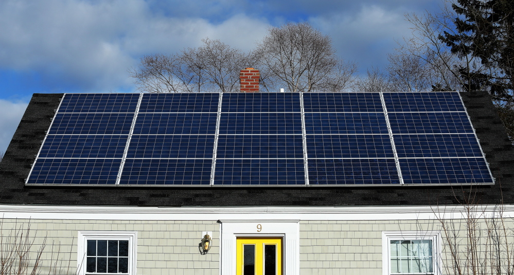 At peak usage times, solar panels like these in Portland feed the power grid without the need for costly new transmission and distribution lines, so it makes little sense to target such customers for higher fees.