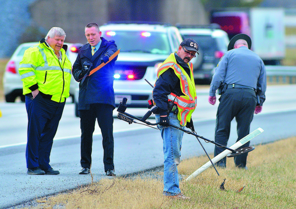 "Franklin County coroner's office staffers and Pennsylvania State Police search Jan. 15 for evidence along Interstate 81 at Exit 3, where a shooting occurred Jan. 4. Timothy ""Asti"" Davison of Poland, Maine, died after being shot multiple times after his vehicle was run off the road."