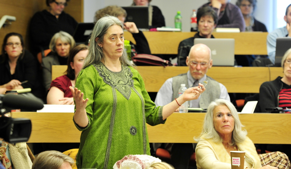 Assunta Kent, an associate professor of theatre, makes a point Friday after USM President Theodora Kalikow announced cutbacks to the school's budget which could result in as many as 50 faculty and staff layoffs.