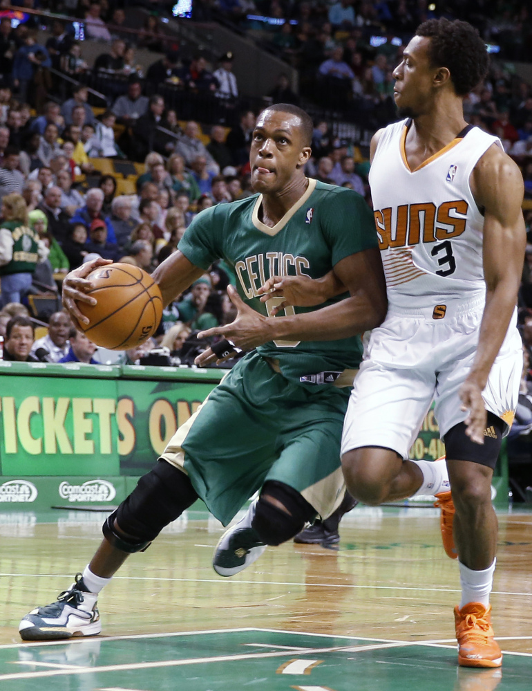 Boston's Rajon Rondo drives on Phoenix's Ish Smith during the first quarter of Friday night's game in Boston, won by the Suns.