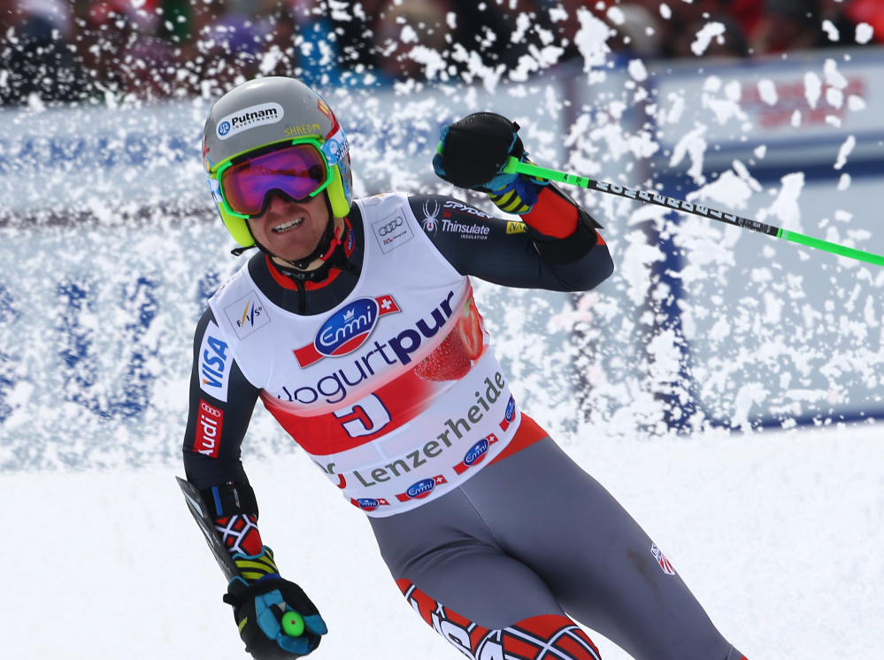 Ted Ligety of the United States celebrates at the finish area after winning the men's giant slalom at the World Cup finals in Lenzerheide, Switzerland on Saturday.
