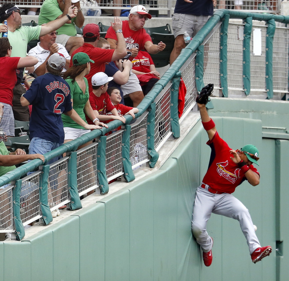 It's a near-miss for St. Louis outfielder John Jay, whose valiant effort to snag a foul ball was for naught during Monday's exhibition game against the Red Sox in Fort Myers, Fla.