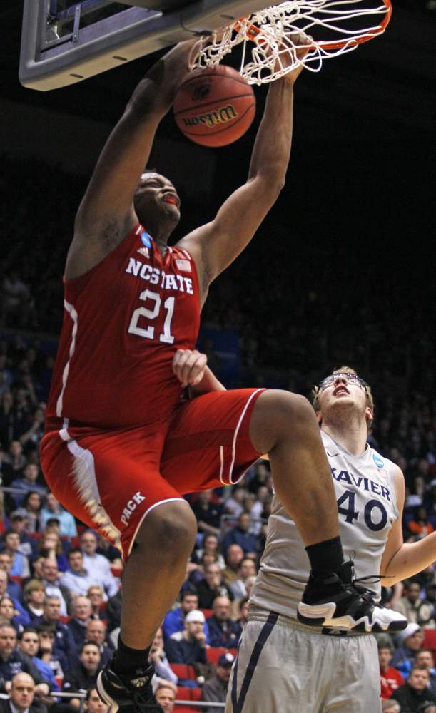 North Carolina State's Beejay Anya dunks against Xavier's Matt Stainbrook during the Wolfpack's NCAA win Tuesday at Dayton, Ohio.