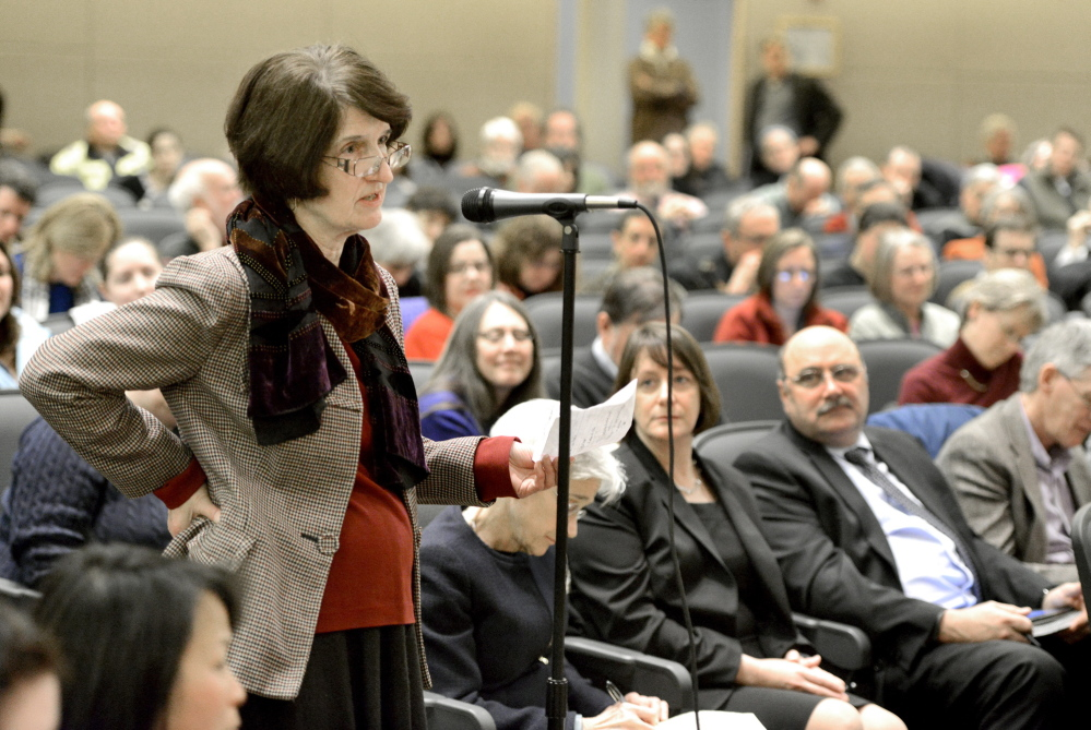 English professor Nancy Gish asks questions to USM president Theodora Kalikow and chancellor James Page with board of trustees in Hannaford Hall on the USM campus in Portland about cuts and reorganization.