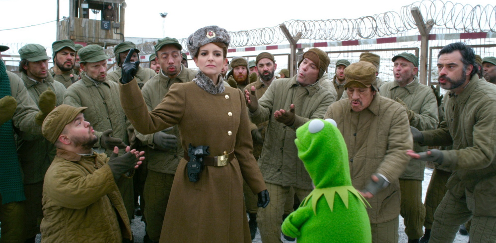 """Tina Fey with Kermit in """"Muppets Most Wanted."""""""