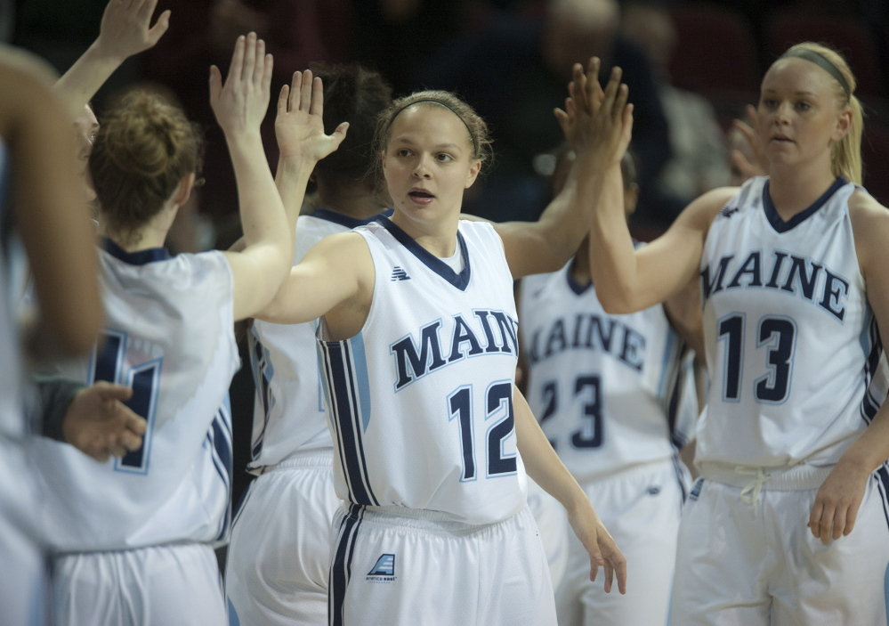 Wednesday was a night for sharing the ball and sharing the love as the University of Maine earned its second postseason victory in its women's basketball history, defeating Bucknell, 77-47. Rachele Burns, 12, congratulates her teammates after the game at the Cross Insurance Center.